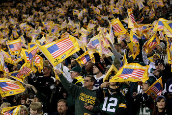 GREEN BAY, WI - NOVEMBER 07: Fans of the Green Bay Packers wave American flags during a pre-game ceremony before a game against the Dallas Cowboys at Lambeau Field on November 7, 2010 in Green Bay, Wisconsin. (Photo by Jonathan Daniel/Getty Images)