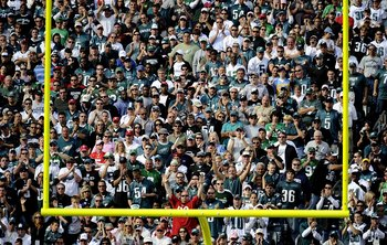 PHILADELPHIA - OCTOBER 11:  Fans of the Philadelphia Eagles cheer from the stands during a game against the Tampa Bay Buccaneers at Lincoln Financial Field on October 11, 2009 in Philadelphia, Pennsylvania.  (Photo by Jeff Zelevansky/Getty Images)