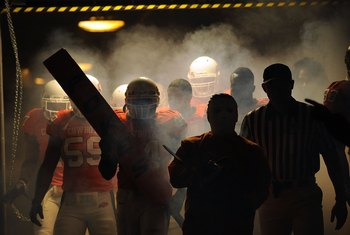 STILLWATER, OK - OCTOBER 31:  The Oklahoma State Cowboys make their way through the tunnel before taking on the Texas Longhorns at Boone Pickens Stadium on October 31, 2009 in Stillwater, Oklahoma.  (Photo by Ronald Martinez/Getty Images)
