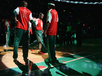 BOSTON - DECEMBER 01:  Rajon Rondo #9 of the Boston Celtics heads out during team introductions before the game against the Portland Trailblazers on December 1, 2010 at the TD Garden in Boston, Massachusetts. NBA players wore special warm up uniforms as p