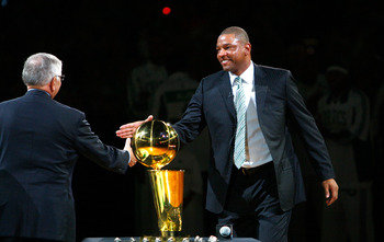 BOSTON, MA - OCTOBER 28: Coach Glenn 'Doc' Rivers of the Boston Celtics shakes hands with NBA Commissioner David Stern during the 2008 NBA World Championship ceremony before a game against the Cleveland Cavaliers at the TD Banknorth Garden on October 28,