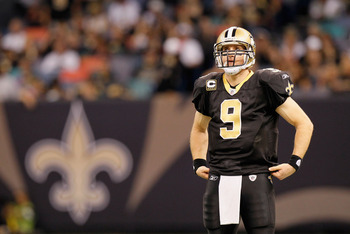 NEW ORLEANS - NOVEMBER 21:  Quarterback Drew Brees #9 of the New Orleans Saints waits during a timeout against the Seattle Seahawks at Louisiana Superdome on November 21, 2010 in New Orleans, Louisiana.  (Photo by Kevin C. Cox/Getty Images)