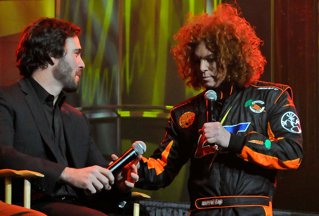 LAS VEGAS, NV - DECEMBER 02:  Comedian Carrot Top speaks with NASCAR driver Jimmie Johnson (L) during the 2010 NASCAR After The Lap show at The Joint inside the Hard Rock Hotel & Casino December 2, 2010 in Las Vegas, Nevada.  (Photo by David Becker/Getty