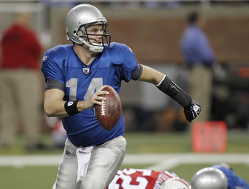 DETROIT - NOVEMBER 25:  Shaun Hill #14 of the Detroit Lions looks for a open reciever while playing the New England Patriots on November 25, 2010 at Ford Field in Detroit, Michigan.  (Photo by Gregory Shamus/Getty Images)