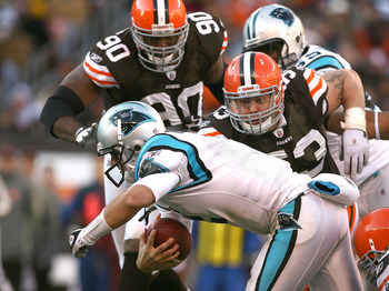 CLEVELAND - NOVEMBER 28:  Quarterback Jimmy Clausen #2 of the Carolina Panthers is sacked by defenders Kenyon Coleman #90 and Matt Roth #53 of the Cleveland Browns at Cleveland Browns Stadium on November 28, 2010 in Cleveland, Ohio.  (Photo by Matt Sulliv
