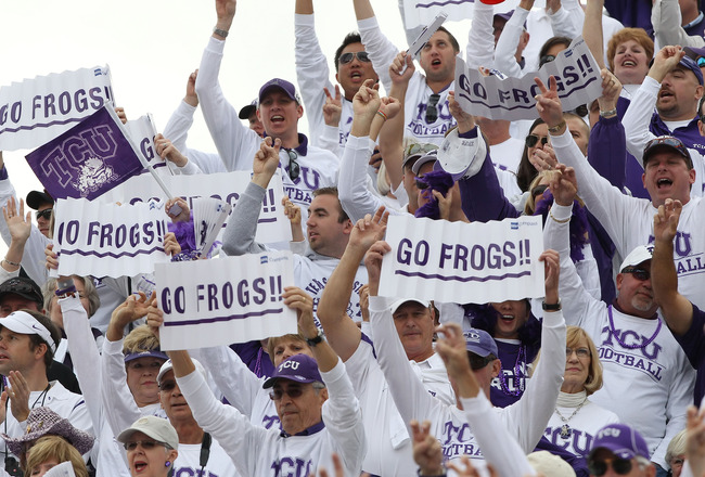 SALT LAKE CITY, UT - NOVEMBER 6: Fans of the TCU Horned Frogs cheer during a game against the Utah Utes during the second half of an NCAA Football game November 6, 2010 at Rice-Eccles Stadium in Salt Lake City, Utah. TCU Beat Utah 47-7.  (Photo by George