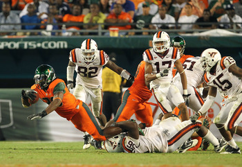 MIAMI - NOVEMBER 20: Patrick Hill #30 of the Miami Hurricanes is tackled after a run by Antoine Hopkins #56 of the Virginia Tech Hokies at Sun Life Stadium on November 20, 2010 in Miami, Florida.  (Photo by Mike Ehrmann/Getty Images)