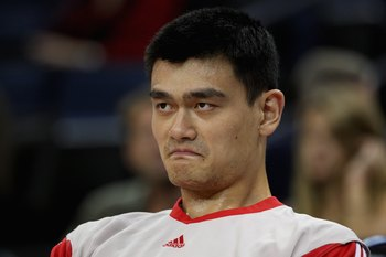 OAKLAND, CA - DECEMBER 12:  Yao Ming #11 of the Houston Rockets sits on the bench during the game against the Golden State Warriors on December 12, 2008 at Oracle Arena in Oakland, California.  The Rockets won 119-108.  NOTE TO USER: User expressly acknow