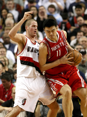PORTLAND, OR - NOVEMBER 06: Yao Ming #11 of the Houston Rockets is defended by Joel Przybilla #10 of the Portland Trail Blazers at the Rose Garden on November 6, 2008 in Portland, Oregon.  NOTE TO USER: User expressly acknowledges and agrees that, by down