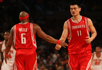 NEW YORK - JANUARY 09:  Yao Ming #11 of the Houston Rockets celebrates a basket with teammate Bonzi Wells #6 against the New York Knicks on January 9, 2008 at Madison Square Garden in New York City. NOTE TO USER: User expressly acknowledges and agrees tha