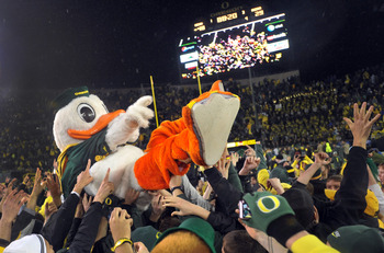 EUGENE, OR - NOVEMBER 26: Oregon Ducks mascot 'Puddles' is lifted on the shoulders of fans after the game against the Arizona Wildcats at Autzen Stadium on November 26, 2010 in Eugene, Oregon. The Ducks won the game 48-29. (Photo by Steve Dykes/Getty Imag