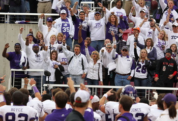 SALT LAKE CITY, UT - NOVEMBER 6: Fans of the TCU Horned Frogs cheer their team after a game against the Utah Utes during the second half of an NCAA Football game November 6, 2010 at Rice-Eccles Stadium in Salt Lake City, Utah. TCU Beat Utah 47-7.  (Photo
