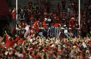 MADISON, WI - OCTOBER 16: Fans of the Wisconsin Badgers celebrate on the field following a win against the Ohio State Buckeyes at Camp Randall Stadium on October 16, 2010 in Madison, Wisconsin. Wisconsin defeated Ohio State 31-18. (Photo by Jonathan Danie
