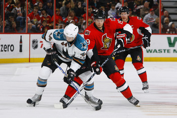 OTTAWA, ON - DECEMBER 02:  Marc-Eduard Vlasic #44 of the San Jose Sharks battles for the puck with Jason Spezza #19 of the Ottawa Senators in a game at Scotiabank Place on December 2, 2010 in Ottawa, Ontario, Canada.  (Photo by Phillip MacCallum/Getty Ima
