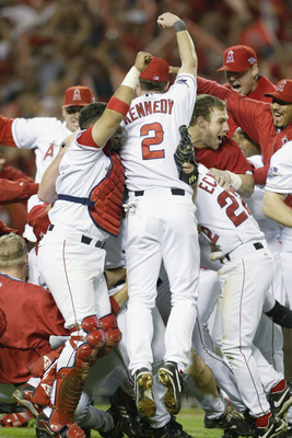 ANAHEIM, CA - OCTOBER 27:  Adam Kennedy #2 of the Anaheim Angels jumps into the celebration of teammates after the victory over the San Francisco Giants in game seven of the World Series on October 27, 2002 at Edison Field in Anaheim, California.  The Ang