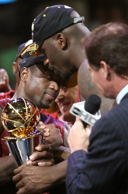 DALLAS - JUNE 20:  Shaquille O'Neal #32 hugs teammate Dwyane Wade #3 of the Miami Heat after Wade won the series MVP trophy after the Heat defeated the Dallas Mavericks in game six of the 2006 NBA Finals on June 20, 2006 at American Airlines Center in Dal