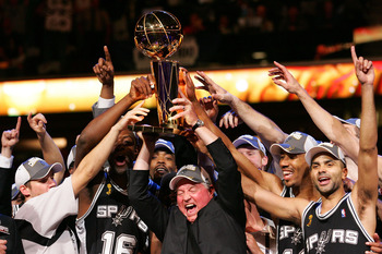 CLEVELAND - JUNE 14: Owner Peter Holt and the San Antonio Spurs receive the Larry O'Brien Championship Trophy after Game Four of the NBA Finals on June 14, 2007 at the Quicken Loans Arena in Cleveland, Ohio. NOTE TO USER: User expressly acknowledges and a