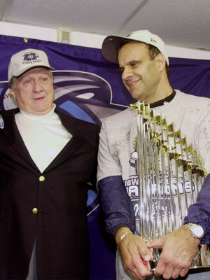 380948 03: New York Yankkees owner George Steinbrenner, left, and manager Joe Torre celebrate October 26, 2000 in the locker room after the Yanks won the World Series Championship over the New York Mets at Shea Stadium in Flushing, New York. (Photo by Ezr