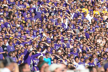 SEATTLE - SEPTEMBER 11:  Fans of the Washington Huskies watch their team take the field prior to the game against the Syracuse Orange on September 11, 2010 at Husky Stadium in Seattle, Washington. (Photo by Otto Greule Jr/Getty Images)