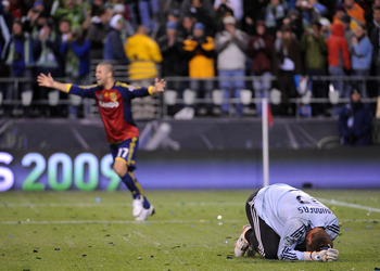 SEATTLE - NOVEMBER 22:  Josh Saunders (R) #12 of the Los Angeles Galaxy reacts after allowing the game winning goal as Chris Wingert (L) #17 of Real Salt Lake celebrates during the MLS Cup final at Qwest Field on November 22, 2009 in Seattle, Washington.