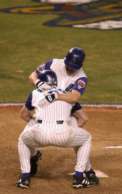 4 Nov 2001: Jay Bell #48 of the Arizona Diamondbacks is met at home plate by teammate Matt Williams #9 as he scores the winning run in the ninth inning against the New York Yankees during game seven of the Major League Baseball World Series at Bank One Ba