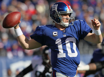 EAST RUTHERFORD, NJ - NOVEMBER 28:  Eli Manning #10 of the New York Giants throws a pass against the Jacksonville Jaguars at New Meadowlands Stadium on November 28, 2010 in East Rutherford, New Jersey.  (Photo by Chris McGrath/Getty Images)