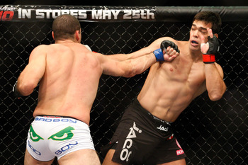 MONTREAL- MAY 8: Mauricio 'Shogun' Rua (L) punches Lyoto Machida in their light heavyweight bout at UFC 113 at Bell Centre on May 8, 2010 in Montreal, Quebec, Canada.  (Photo by Richard Wolowicz/Getty Images)