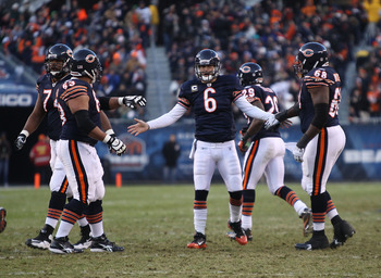 CHICAGO - NOVEMBER 28: Jay Cutler #6 of the Chicago Bears congratulates teammates (L-R) Chris Williams #74, Roberto Garza #63 and Frank Omiyale #68 after a touchdown throw against the Philadelphia Eagles at Soldier Field on November 28, 2010 in Chicago, I