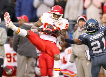 SEATTLE, WA - NOVEMBER 28:  Wide receiver Dwayne Bowe #82 of the Kansas City Chiefs makes a catch for a first down with under six minutes to go against Kelly Jennings #21 of the Seattle Seahawks at Qwest Field on November 28, 2010 in Seattle, Washington.