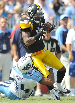 NASHVILLE, TN - SEPTEMBER 19:  Mike Wallace #17 of the Pittsburgh Steelers makes a catch as Chris Hope #24 of the Tennessee Titans defends during the first half at LP Field on September 19, 2010 in Nashville, Tennessee.  (Photo by Grant Halverson/Getty Im