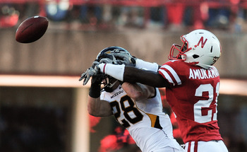 LINCOLN, NE - OCTOBER 30: Cornerback Prince Amukamara #21 of the Nebraska Cornhuskers breaks up a pass intended for wide receiver T.J. Moe #28 of the Missouri Tigers during first half action of their game at Memorial Stadium on October 30, 2010 in Lincoln