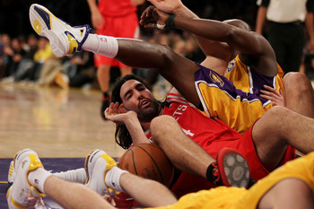 LOS ANGELES, CA - OCTOBER 26:  Luis Scola #4 of the Houston Rockets lays on the ground after a play against the Los Angeles Lakers during their opening night game at Staples Center on October 26, 2010 in Los Angeles, California. NOTE TO USER: User express