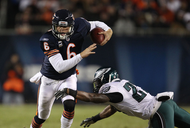 CHICAGO - NOVEMBER 28: Jay Cutler #6 of the Chicago Bears breaks away from Quintin Mikell #27 of the Philadelphia Eagles at Soldier Field on November 28, 2010 in Chicago, Illinois. The Bears defeated the Eagles 31-26. (Photo by Jonathan Daniel/Getty Image