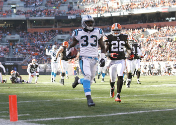 CLEVELAND - NOVEMBER 28:  Running back Mike Goodson #33 of the Carolina Panthers scores a touchdown in front of defensive back Abram Elam #26 of the Cleveland Browns at Cleveland Browns Stadium on November 28, 2010 in Cleveland, Ohio.  (Photo by Matt Sull