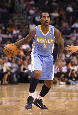 PHOENIX - OCTOBER 22:  J.R. Smith #5 of the Denver Nuggets handles the ball during the preseason NBA game against the Phoenix Suns at US Airways Center on October 22, 2010 in Phoenix, Arizona. NOTE TO USER: User expressly acknowledges and agrees that, by