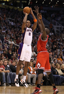 PHOENIX - NOVEMBER 24:  Channing Frye #8 of the Phoenix Suns puts up a shot during the NBA game against the Chicago Bulls at US Airways Center on November 24, 2010 in Phoenix, Arizona. NOTE TO USER: User expressly acknowledges and agrees that, by download