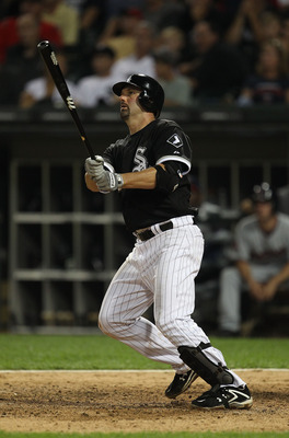 CHICAGO - AUGUST 10: Paul Konerko #14 of the Chicago White Sox hits a double against the Minnesota Twins at U.S. Cellular Field on August 10, 2010 in Chicago, Illinois. The Twins defeated the White Sox 12-6. (Photo by Jonathan Daniel/Getty Images)