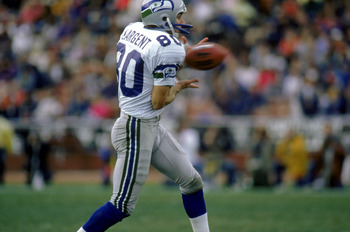 LOS ANGELES - DECEMBER 18:  Wide receiver Steve Largent #80 of the Seattle Seahawks catches a pass during a game against the Los Angeles Raiders at the L.A. Coliseum on December 18, 1988 in Los Angeles, California.  The Seahawks defeated the Raiders 43-37