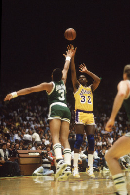 LOS ANGELES - 1987:  Magic Johnson #32 of the Los Angeles Lakers shoots over Dennis Johnson #3 of the Boston Celtics during an NBA Finals game at the Great Western Forum in Los Angeles, California in 1987. (Photo by: Mike Powell/Getty Images)