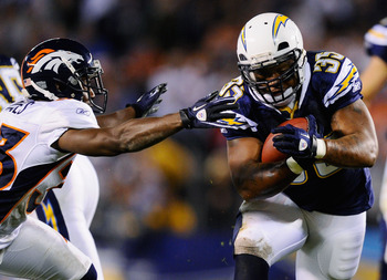 SAN DIEGO - NOVEMBER 22:  Mike Tolbert #35 of the San Diego Chargers breaks a tackle against Nate Jones #33 of the Denver Broncos as he rushes for a gain at Qualcomm Stadium on November 22, 2010 in San Diego, California.  (Photo by Kevork Djansezian/Getty