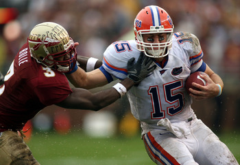 TALLAHASSEE, FL - NOVEMBER 29:  Safety Myron Rolle #3 of the Florida State Seminoles tackles quarterback Tim Tebow #15 of the Florida Gators during the first half at Bobby Bowden Field at Doak Campbell Stadium on November 29, 2008 in Tallahassee, Florida.