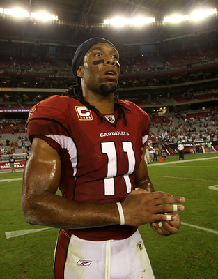 GLENDALE, AZ - NOVEMBER 14:  Wide receiver Larry Fitzgerald #11 of the Arizona Cardinals walks off the field after the game with the Seattle Seahawks at University of Phoenix Stadium on November 14, 2010 in Glendale, Arizona. Seattle won 36-18.  (Photo by