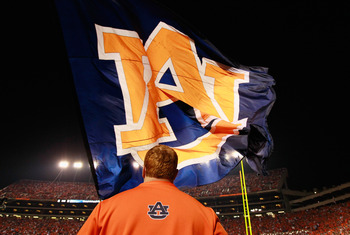 AUBURN, AL - NOVEMBER 13:  Cheerleaders of the Auburn Tigers wave one of their giant flags against the Georgia Bulldogs at Jordan-Hare Stadium on November 13, 2010 in Auburn, Alabama.  (Photo by Kevin C. Cox/Getty Images)
