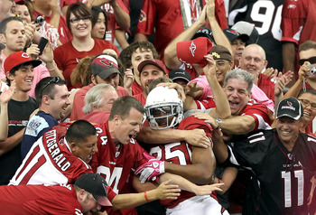 GLENDALE, AZ - OCTOBER 10:  Safety Kerry Rhodes #25 of the Arizona Cardinals celebrates with fans after scoring a touchdown on a fumble recovery during the fourth quarter of the NFL game against the New Orleans Saints at the University of Phoenix Stadium