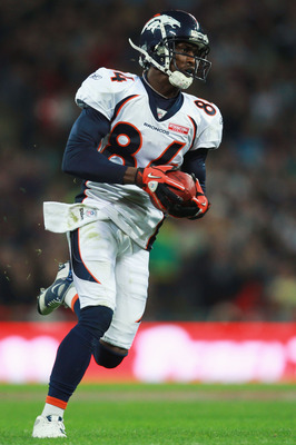LONDON, ENGLAND - OCTOBER 31:  Brandon Lloyd #84 of Denver Broncos makes a break for the end zone during the NFL International Series match between Denver Broncos and San Francisco 49ers at Wembley Stadium on October 31, 2010 in London, England. This is t