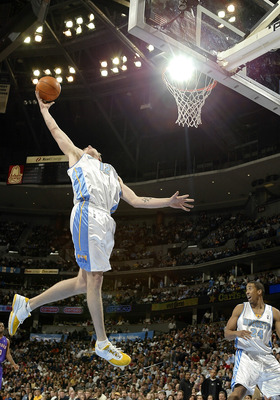 DENVER - DECEMBER 30:  Chris 'Birdman' Andersen#12 of the Denver Nuggets gets a defensive rebound against the Toronto Raptors in the second half of the game December 30, 2003 at the Pepsi Center in Denver, Colorado. The Raptors won 81-74.  NOTE TO USER: