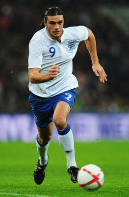 LONDON, ENGLAND - NOVEMBER 17:  Andy Carroll of England runs with the ball during the international friendly match between England and France at Wembley Stadium on November 17, 2010 in London, England.  (Photo by Mike Hewitt/Getty Images)