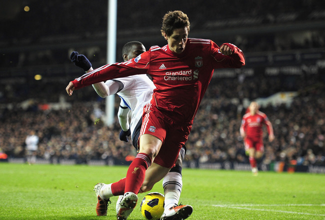 LONDON, ENGLAND - NOVEMBER 28:  Fernando Torres of Liverpool is tackled by Sebastien Bassong of Tottenham Hotspur during the Barclays Premier League match between Tottenham Hotspur and Liverpool at White Hart Lane on November 28, 2010 in London, England.