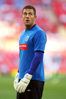 LONDON, ENGLAND - AUGUST 11:  Scott Loach of England looks on as he warms up prior to the International Friendly match between England and Hungary at Wembley Stadium on August 11, 2010 in London, England.  (Photo by Richard Heathcote/Getty Images)