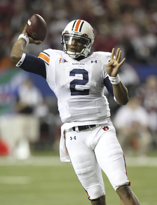 ATLANTA - DECEMBER 4:  Quarterback Cam Newton #2 of the Auburn Tigers throws a first quarter touchdown pas during the 2010 SEC Championship against the South Carolina Gamecocks at Georgia Dome on December 4, 2010 in Atlanta, Georgia. (Photo by Mike Zarril